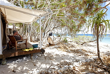 Luxury tent on stilts right at the beach under Pandanus trees, Wilson Island Resort, Wilson Island, part of the Capricornia Cays National Park, Great Barrier Reef Marine Park, UNESCO World Heritage Site, Queensland, Australia