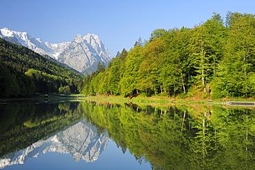 Zugspitze range with Waxenstein reflecting in lake Riessersee, Riessersee, Garmisch-Partenkirchen, Wetterstein range, Werdenfels, Upper Bavaria, Bavaria, Germany, Europe