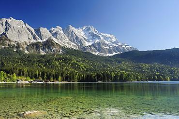 Zugspitze above lake Eibsee in the sunlight, lake Eibsee, Garmisch-Partenkirchen, Wetterstein range, Werdenfels, Upper Bavaria, Bavaria, Germany, Europe