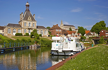 The village Long on the river Somme with townhall, church and houseboat, Dept. Somme, Picardie, France, Europe