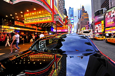 Reflection on the surface of black car, Times Square, Manhattan, New York City, USA