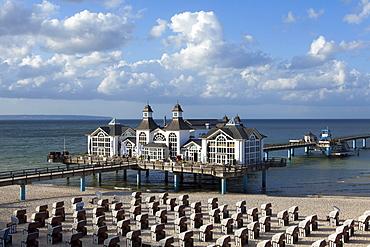 Clouds over the pier and beach, Sellin seaside resort, Ruegen island, Baltic Sea, Mecklenburg-West Pomerania, Germany