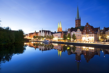 View over the Trave river to the old town of Luebeck with St Mary¥s church and church of St Petri, Hanseatic city of Luebeck, Baltic Sea, Schleswig-Holstein, Germany