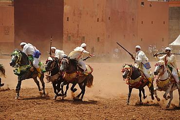 Men on horseback carrying guns, Fantasia festival for the Moussem at Azilal, High Atlas, Morocco, Africa