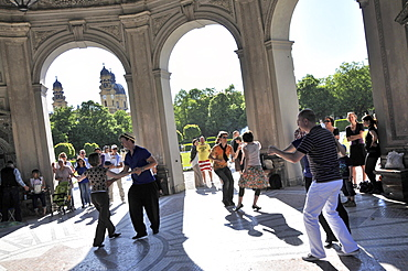 People dancing at the Diana temple at the Hofgarten, Munich, Bavaria, Germany, Europe