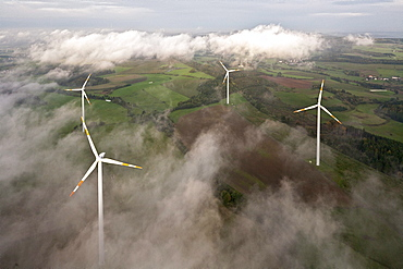 Aerial view of wind wheels at a wind turbine park in the fog, Eifel, Rhineland Palatinate, Germany, Europe