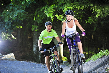 Two mountain bikers in a bike park, Hochries, Samerberg, Upper Bavaria, Germany