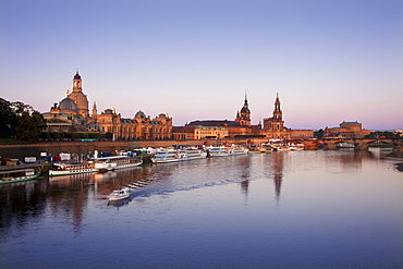Panoramic view over the Elbe river to Bruehlsche Terrasse, University of visual arts, Frauenkirche, Staendehaus, Dresden castle, Hofkirche and Semper Opera in the evening, Dresden, Saxonia, Germany, Europe