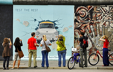 People in front of paintings of the East Side Gallery, Berliner Mauer, Muehlenstrasse, Berlin, Germany, Europe