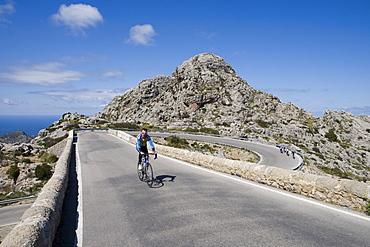 Cyclists on Sa Calobra Mountain Road, Near Cala de Sa Calobra, Mallorca, Balearic Islands, Spain
