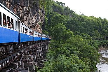 Tourist train on wooden trestle viaduct of Trans River Kwai Death Railway at Saphan Tham Krasae, near Kanchanaburi, Thailand