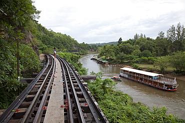Wooden trestle viaduct of Trans River Kwai Death Railway at Saphan Tham Krasae with river cruise ship RV River Kwai (Cruise Asia Ltd.) on River Kwai Noi, near Kanchanaburi, Thailand