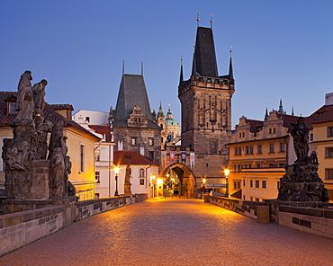 Charles bridge and city gate in the evening, Prague, Czechia, Europe