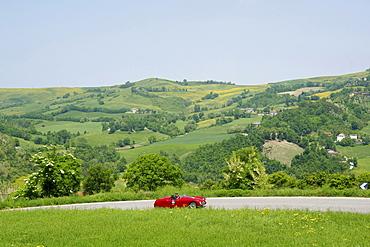 Vintage car on a country road, Monte Cerignone, Pesaro Urbino, Italy, Europe