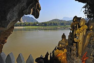 Buddha statues, Pak Ou caves, Mekong river, north of Luang Prabang, Laos