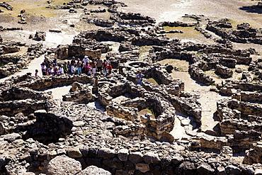 Tourists, at the ruins, Nuraghe Su Nuraxi, Barumi, Sardinia, Italy
