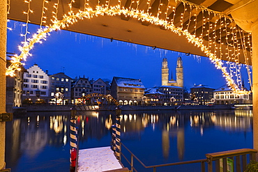 Pier at the Hotel Storchen, old town center, river Limmat at night, Limmatquai Grossmunster, Zurich, Switzerland