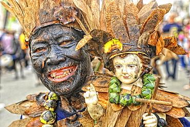 Toothless man holding a holy Santo Nino doll, Ati Atihan festival, Kalibo, Aklan, Panay Island, Visayas, Philippines