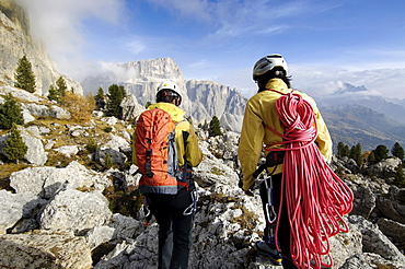 Two mountaineers with climbing rope, Alto Adige, South Tyrol, Italy, Europe