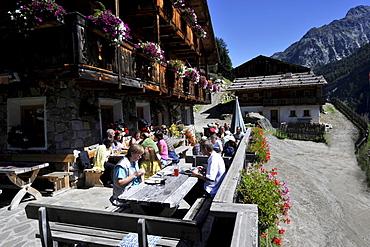 Hiker during eating in the farmhouse inn, Ahrn Valley, Alto Adige, South Tyrol, Italy