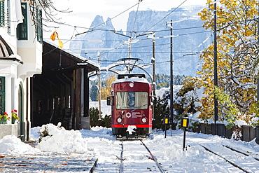 The Ritten railway in the fresh snow, Soprabolzano, Schlern, South Tyrol, Alto Adige, Italy, Europe