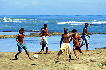 Boys playing football on the beach, Puerto Viejo, Costa Rica, Caribbean, America