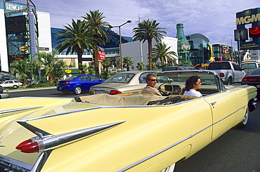 A couple in a Cadillac on Las Vegas Boulevard, Las Vegas, Nevada, USA, America