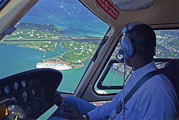 Pilot in helicopter over Castries, St. Lucia, Caribbean, America