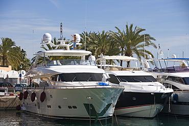 Man Scrubs Deck aboard Luxury Yacht in Puerto Portals Marina, Puerto Portals, Mallorca, Balearic Islands, Spain
