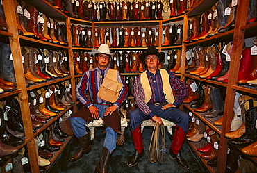 Two men wearing cowboy hats in a shop with cowboy boots, Fort Worth, Texas, USA, America