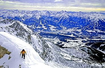 Alpinist doing back country skiing, mountain panorama, Hoher Dachstein, Dachstein, Austria