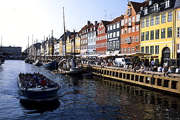 Nyhavn Sightseeing Boat, Old houses, boats and CafÈs along the Nyhavn Canal, Copenhagen, Denmark