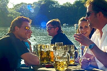 Young people in Seehaus Beergarden, English Garden, Munich, Bavaria, Germany