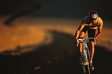 Man riding a racing bike through Death Valley, Bike tour, Death Valley, California, USA