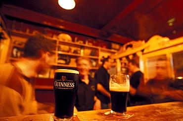 Glass of Guiness on the counter of O' Riadas Pub, Parliament Street, Kilkenny, Ireland, Europe