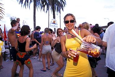 Young people in the Bora Bora Beach Disco, Club, Playa d'en Bossa, Ibiza, Spain