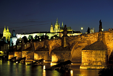 The illuminated Charles Bridge in the evening, Hradcany, Prague, Czechia, Europe