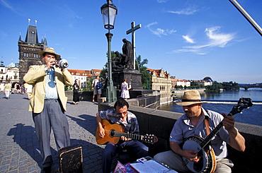 Musicians on Charles Bridge in the sunlight, Prague, Czechia, Europe