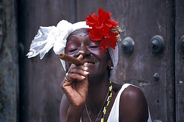 Mature woman smoking a cigar at the old town, Plaza de la Catedral, La Habana Vieja, Cuba, Caribbean, America