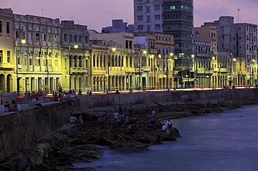 Illuminated houses at the esplanade in the evening, Malecon, Havana, Cuba, Caribbean, America