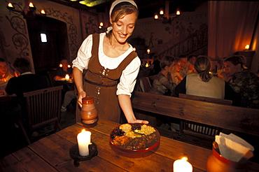 Waitress in medieval costume at Olde Hansa restaurant, Tallinn, Estonia, Europe