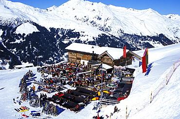 People at the Fuxaegufer Huette, Jakobshorn, Apres Ski, Grisons, Switzerland
