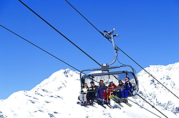 Six people sitting in a ski Lift, Skiing, Stubaital Glacier, Tirol, Austria