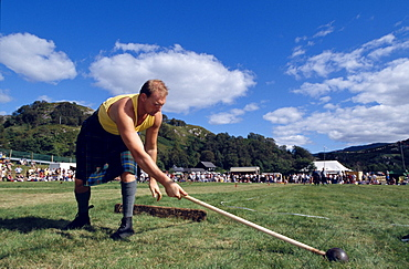 Man with kilt holding a sledge hammer, Glenfinnan Highland Games, Invernesshire, Scotland, Great Britain, Europe