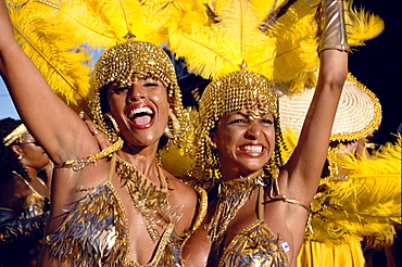 Women in costumes dancing at Mardi Gras, Port of Spain, Trinidad and Tobago