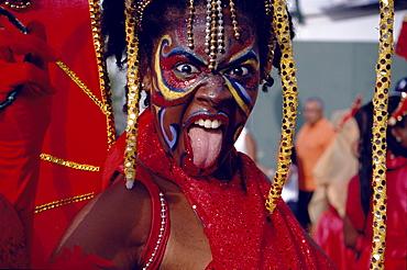 Woman in costume dancing at Mardi Gras, Port of Spain, Trinidad and Tobago, Caribbean