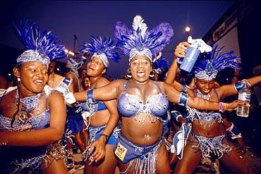 Women in costumes dancing at Mardi Gras, Port of Spain, Trinidad and Tobago, Caribbean
