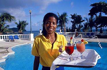 Waitress carrying cocktails at the pool of Hotel Gran Bahia, Samana, Samana Peninsula, Dominican Republic, Caribbean
