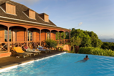 Relaxing in front of the pool of Hotel Le Jardin Malanga, Trois Rivieres, Basse-Terre, Guadeloupe, Caribbean Sea, America