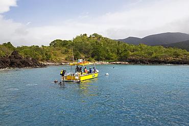 People on a boat of the diving school off shore, Bouillante, Basse-Terre, Guadeloupe, Caribbean Sea, America